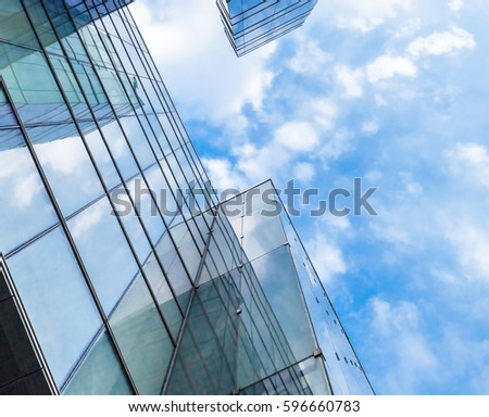 low angle view of modern building exterior with cloud reflect on glass #596660783
