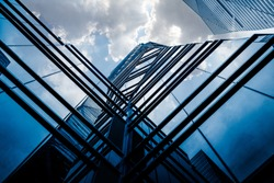 low angle view of modern glass building in the city