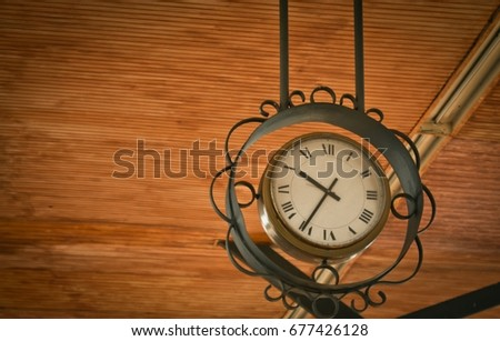 low angle view of old clock...