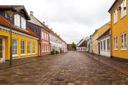 Low angle view of old street in the inner city of Odense, Denmark.