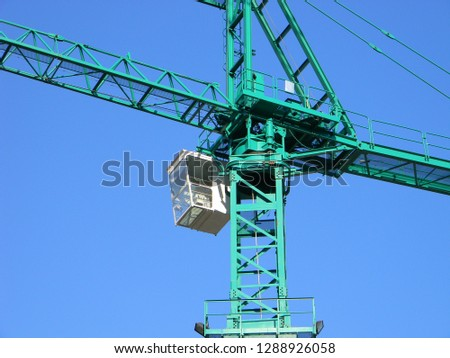 Low angle view of operator's cabin and slewing unit of a tower crane, Tirana, Albania