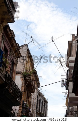 Low angle view of satellite dishes and facades in La Havana, Cuba #786589018