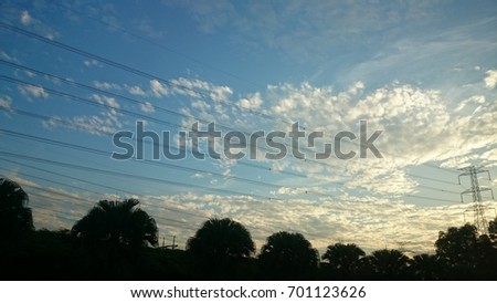 Low Angle View Of Silhouette Electric cable Built Structures Against Scenic Sky #701123626