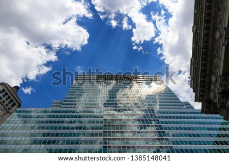Low Angle view of Skyscraper at Financial District in New York City, USA with blue sky. Business area in downtown Manhattan surrounding with skyscrapers. #1385148041