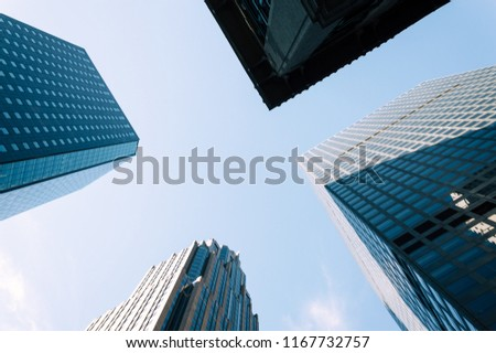 Low angle view of skyscrapers against blue sky in Nerw York with space for copy, Directly below view #1167732757