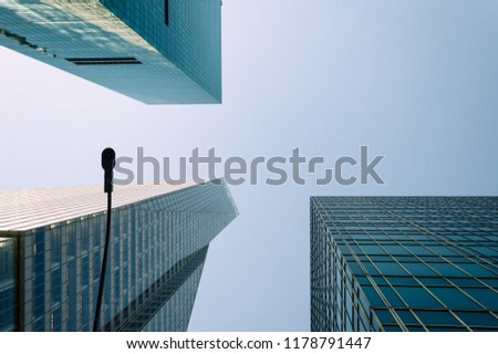 Low angle view of skyscrapers against blue sky in Nerw York with space for copy, Directly below view #1178791447