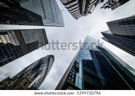 Low angle view of skyscrapers. Looking up perspective. Bottom view of modern skyscrapers in business district. Business concept of success industry #1299720796