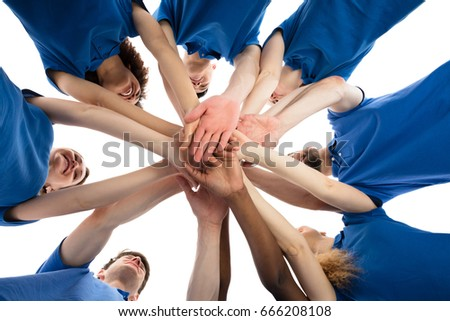 Low Angle View Of Smiling Multiracial Janitors Stacking Hands #666208108