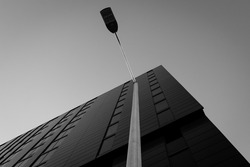Low Angle View of Streetlight in Front of Modern Office Building