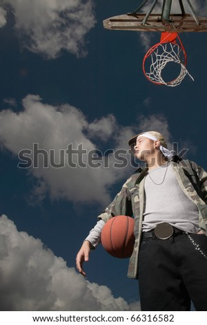 Low angle view of teenage boy on basketball court