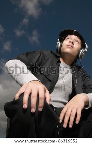 Low angle view of teenage boy wearing headphones