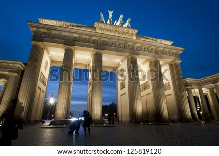 Low angle view of the historical Brandenburg Gate, or Brandenburger Tor, Berlin, Germany illuminated at night