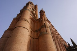 Low angle view of the 78-meter high bell tower of the medieval Sainte-Cécile's Cathedral in Albi, France ; this gothic UNESCO World Heritage Site is the largest brick-built building worlwide
