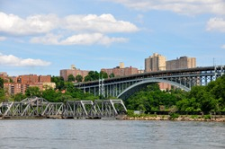 Low angle view of the Spuyten Duyvil Bridge and the Henry Hudson Bridge that both cross the Spuyten Duyvil Creek between Manhattan and the Bronx, New York City