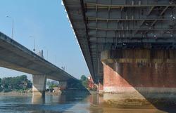 Low angle view of Vivekananda Setu or Bally Bridge and Nivedita Setu from a river boat beneath the bridge. View of girders and concrete pillar supporting the bridge on Hooghly river.