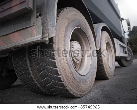 Low angle view of wheels of heavy truck #85745965