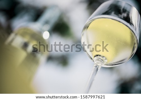 Low angle view of wine bottle and wine glass