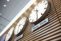 Low angle view of world time zone clocks