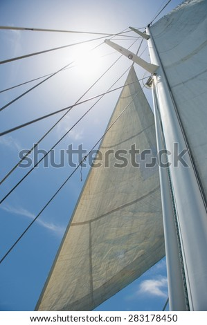Low angle view of yacht sails and mast against sky #283178450