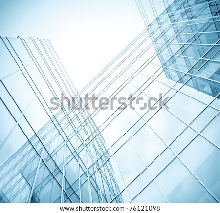 low angle view to light glass buildings of business center
