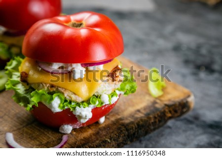 Low carb burger option - tomato burger #1116950348