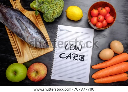Low carb (food), health conceptual. Healthy fresh low carbohydrates food; egg, fish, lemon, tomatoes, apple, carrot and broccoli. #707977780