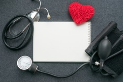 Low carb, low carb high fat (LCHF), Keto, ketogenic diet mockup with white notebook, red thread heart with tonometer on grey table. Benefits, What Eat, How to Reach Ketosis, Optimal Macros