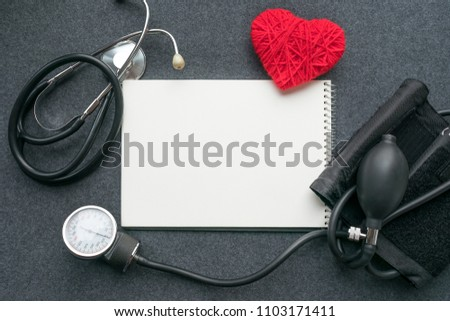 Low carb, low carb high fat (LCHF), Keto, ketogenic diet mockup with white notebook, red thread heart with tonometer on grey table. Benefits, What Eat, How to Reach Ketosis, Optimal Macros #1103171411