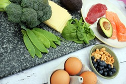 Low carb style diet protein based meat fish dairy eggs veg spinach berries and nuts for healthy weight loss through natural balanced diet by ketosis