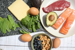 Low carb style diet protein based meat fish dairy eggs veg spinach berries and nuts for healthy weight loss through natural balanced diet ketosis