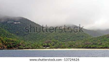 Low clouds and stormy weather at Trunk Bay on St John in the US Virgin Islands.