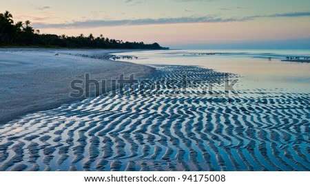 Low coastal tide at the beach in Naples, Florida