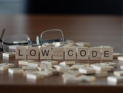 low code concept represented by wooden letter tiles