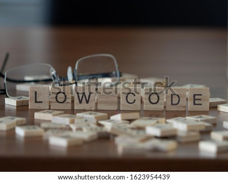 Photo of  low code concept represented by wooden letter tiles