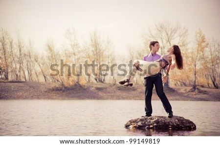 low contrast portrait of a happy young couple  outdoor in the autumn park