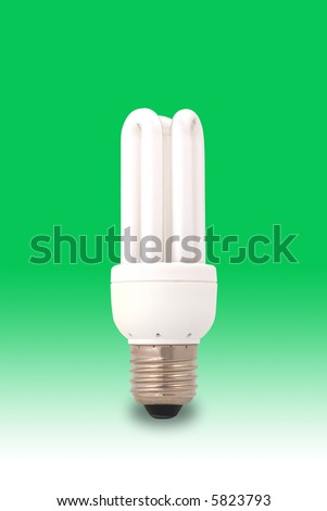 Low energy light bulb on a green background