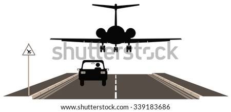 Shutterstock Low flying aircraft over road warning sign