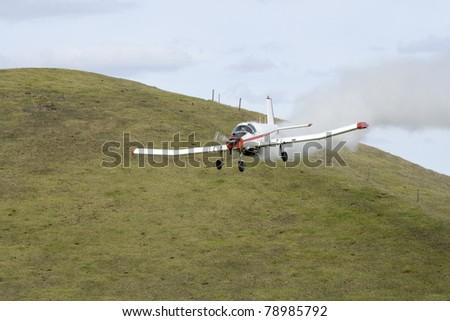 Low Flying Crop Duster Spraying Fertilizer