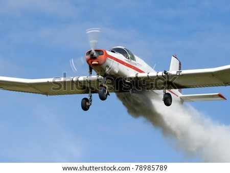 Low Flying Crop Duster Spraying Fertilizer - Close Up of Under Carriage