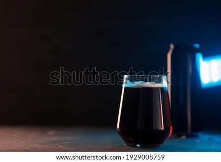 low glass of dark stout or porter beer, dark copyspace background, blue light Stock photo ©