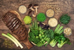 Low glycemic diabetic health food for weight loss & fitness with foods high in vitamins, minerals, antioxidants, smart carbs, omega 3 and protein. Below 55 on the GI index. Top view on rustic wood.