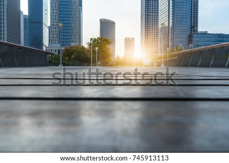 Low ground angle view of wooden footpath front modern building #745913113