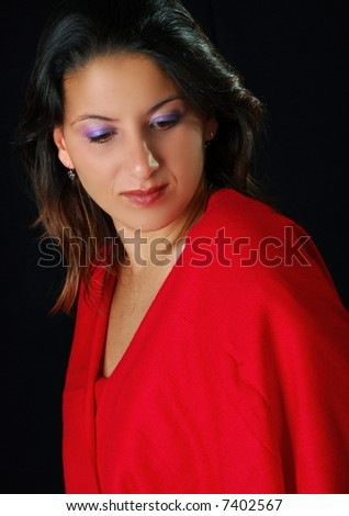 Low key image of a young woman in red