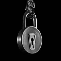 low key image of old lock in black and white