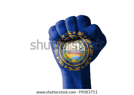 Low key picture of a fist painted in colors of american state flag of new hampshire