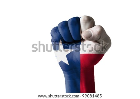 Low key picture of a fist painted in colors of american state flag of texas