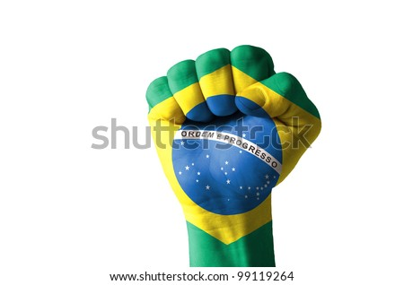 Low key picture of a fist painted in colors of brazil flag