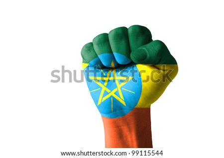 Low key picture of a fist painted in colors of ethiopia flag