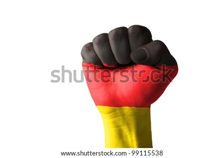 Low key picture of a fist painted in colors of germany flag