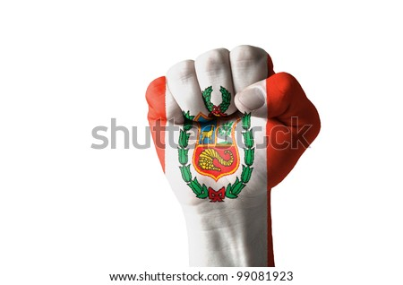 Low key picture of a fist painted in colors of peru flag